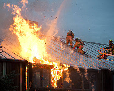 Firemen putting out a house fire